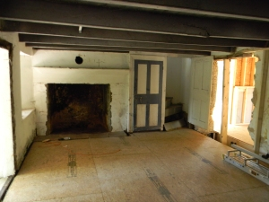 The old fireplace is opened