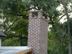 The top of the chimney with a fieldstone cap.