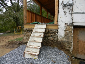 Repurposed half stairs to the porch.  We need something sturdier for moving day!