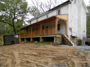"""Mud, temporary stairs and a dumpster. Not quite ready for the """"after"""" picture just yet."""