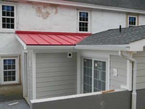 Our mud room red roof gives the look of a