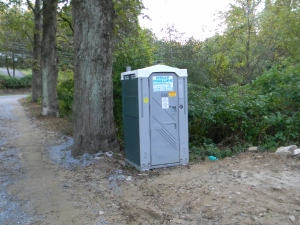 Grandmom's Outhouse -- a green/gray Port-a-Potty in the front yard